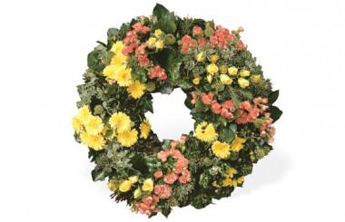 image de la couronne de deuil jaune et rose du nom de témoignage éternel