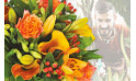 L'Agitateur Floral | image du Bouquet Surprise du fleuriste tons oranges
