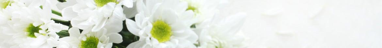 Livraison de Coeurs en fleurs de deuil par un artisan fleuriste